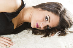 Young woman lying on a rug Royalty Free Stock Photos