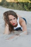Young woman lying on the sand Royalty Free Stock Photo