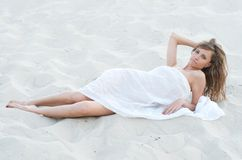 Young woman lying on the sand Stock Photo