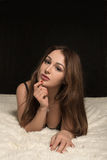 Young woman lying Royalty Free Stock Image