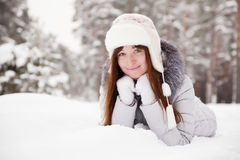 Young woman lying on  snow Royalty Free Stock Images