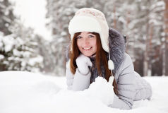 Young woman lying on  snow Royalty Free Stock Photo