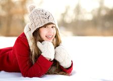 Young Woman Lying in the Snow Stock Photography