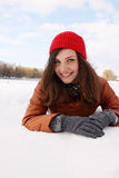 Young woman lying in the snow Royalty Free Stock Photography