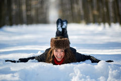 Young woman lying in the snow Stock Image