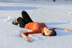 Young woman lying in a snow Royalty Free Stock Photo