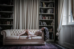 Young woman lying on the sofa Stock Photography