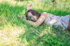 Young woman lying on soft  fresh spring grass Stock Photography