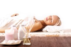 Young woman lying at spa Royalty Free Stock Photos