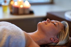 Young woman lying in spa Stock Images