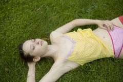Young woman lying  in summer park Stock Photography