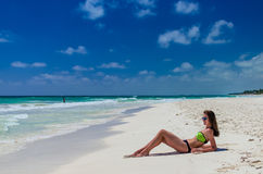 Young woman getting sun at tropical white beach Stock Images