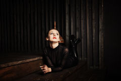 Young woman lying on the wooden steps Royalty Free Stock Image