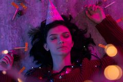 Young woman lying with xmas glowing lights Celebration, Christmas, New Year. stock photography