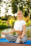 Young woman maditating in lotus pose Stock Images