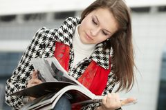 Young woman with magazine Stock Photo