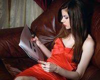 Young woman with magazine royalty free stock image