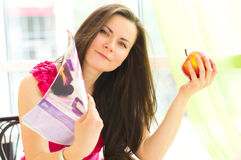 Young woman with magazine. And apple Royalty Free Stock Photography