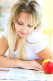 Young woman with magazine. And apple Royalty Free Stock Photos