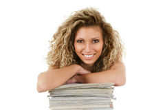 Young woman with magazines Royalty Free Stock Photo