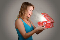 Young woman with magic christmas gift Royalty Free Stock Image