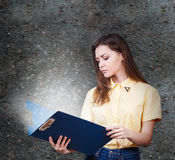 Young woman with magic folder Stock Photo
