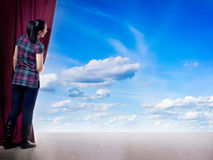 Young woman in magic scene open curtain Stock Image
