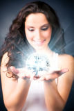 Young woman with magic shine ball. On dark background Stock Photos
