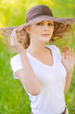 Young woman in magnificent hat Royalty Free Stock Photos