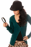Young woman with magnifier glass and hat looking Stock Photo