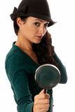 Young woman with magnifier glass looking camera Royalty Free Stock Image