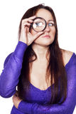 Young woman with magnifying glass over isolated background Stock Photo