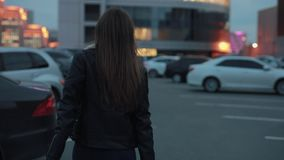 Young woman make follow me gesture in the evening city. Young woman make a follow me gesture walking in the evening city stock video footage