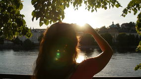 Young Woman make hearth symbol in sunset. Woman make hearth symbol in sunset stock video footage