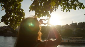 Young Woman make hearth symbol in sunset. Woman make hearth symbol in sunset stock footage