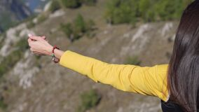 Young woman make a meditation dances high in the mountains. Close-up hand stock footage