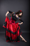Young woman make step in spanish traditional clothes Royalty Free Stock Photos