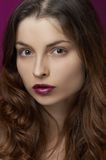 Young woman with make-up. On the violet background stock photo