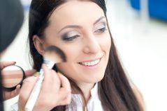 Young woman at make up artist Stock Photos