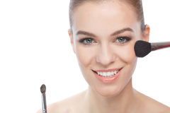 Young woman and make-up brushes Royalty Free Stock Image