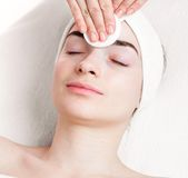 Young woman make up removing in beauty parlour Stock Images