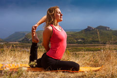 Young woman make yoga pose deeply concentrated Stock Photography