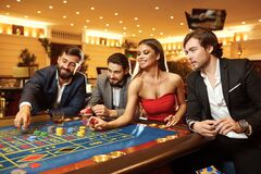 Free Young Woman Makes A Bet At The Casino Roulette Poker. Royalty Free Stock Photo - 170634745