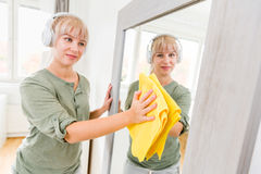 Young woman makes cleaning Royalty Free Stock Photos