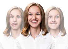 Young woman makes fun faces Stock Images