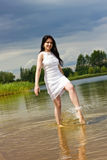 Young woman makes fun on the lake Stock Photography