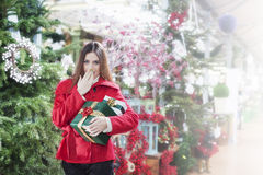 Young woman makes a gesture of surprise for Christmas gifts Stock Images