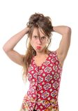A young woman makes a grimace Royalty Free Stock Photos