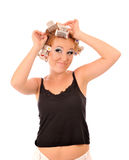 Young woman makes hair curlers. Stock Photos