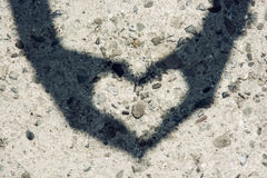 Young woman makes heart shadow with her hands Royalty Free Stock Photo